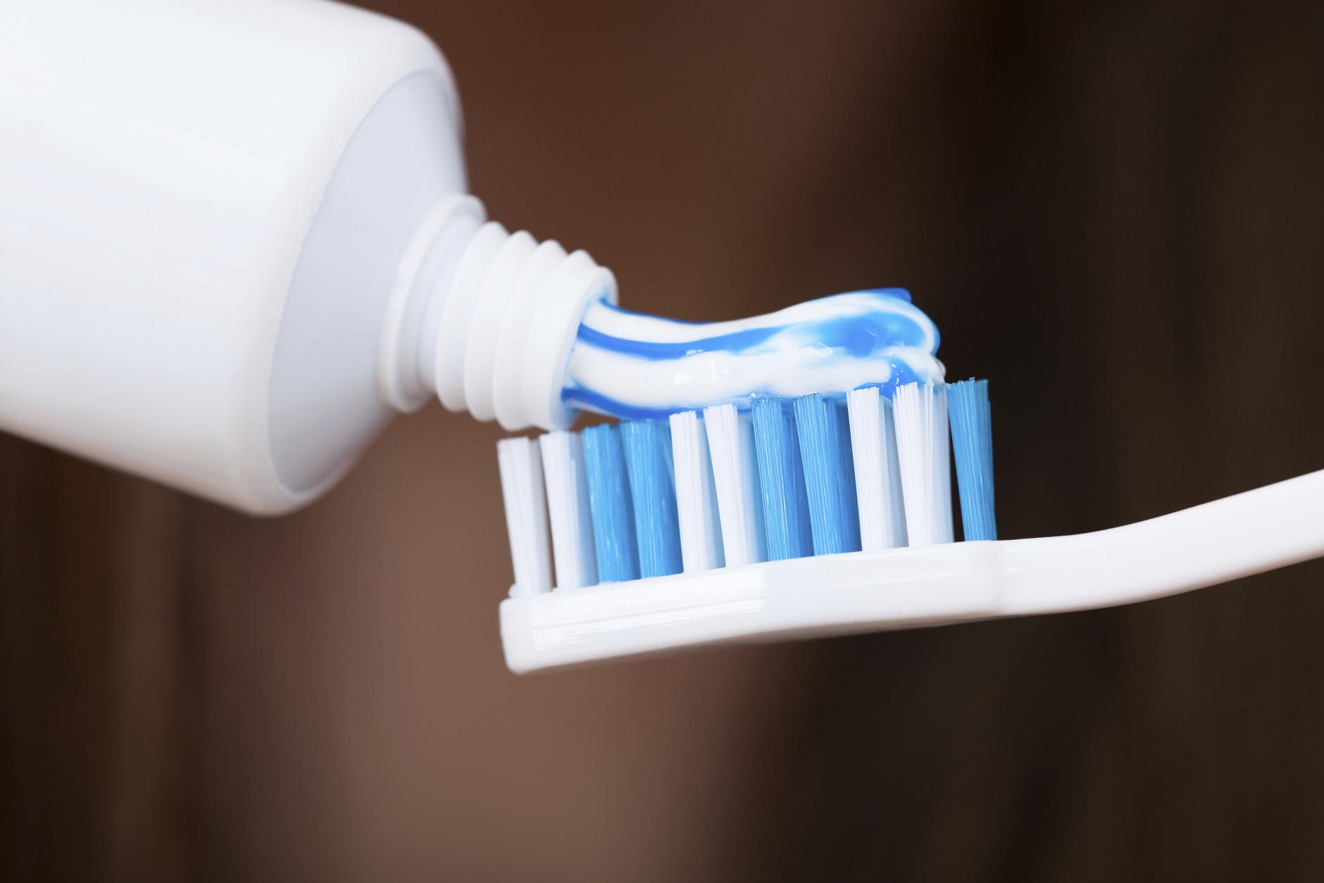 Adding Toothpaste On Brush