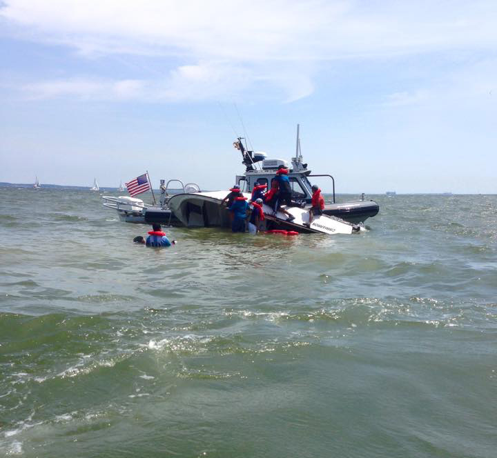 7 people rescued after boat capsizes in Whitehall Bay