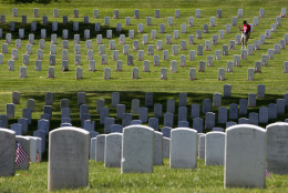 Tom Nicholson of Gretna, Neb. visits graves at Arlington National Ceremony in Arlington, Va., Monday,May 25, 2015, ahead of a Memorial Day ceremonies. Nicholson's son, Marine Captain Kevin Nicholson, died serving in Afghanistan in 2014. (AP Photo/Jacquelyn Martin)
