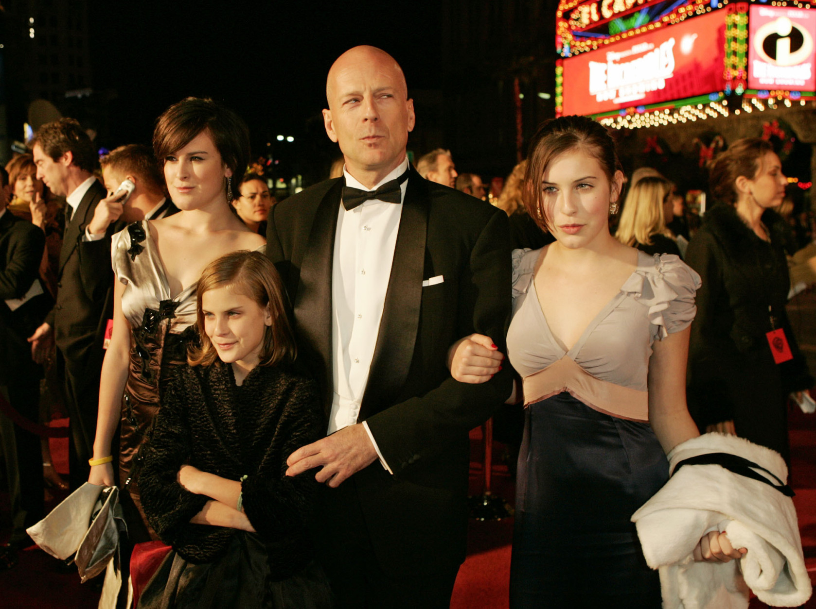 "Actor Bruce Willis poses with his daughters Rumer, left, Tallulah Belle, center, and Scout LaRue as they arrive for the premiere of ""Ocean's Twelve,"" at the Grauman's Chinese Theatre in the Hollywood section of Los Angeles, Wednesday, Dec. 8, 2004. (AP Photo/Kevork Djansezian)"