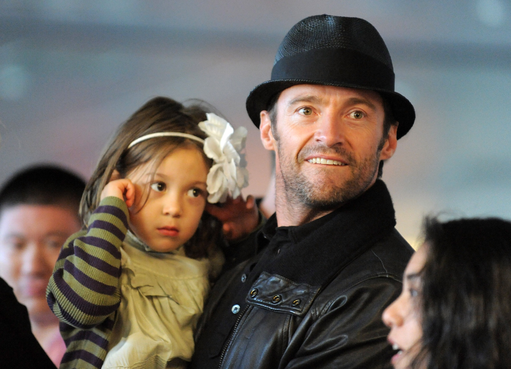 Actor Hugh Jackman holds his daughter Ava during a boxing competition charity event to benefit The East Harlem School at Exodus House, Wednesday, May 13, 2009 at the Aerospace High Performance Center in New York. (AP Photo/Evan Agostini)