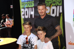 David Beckham, right, and his sons, from left, Romeo James Beckham and Cruz David Beckham arrive at the Kids' Choice Sports Awards at UCLA's Pauley Pavilion on Thursday, July 17, 2014, in Los Angeles. (Photo by Chris Pizzello/Invision/AP)