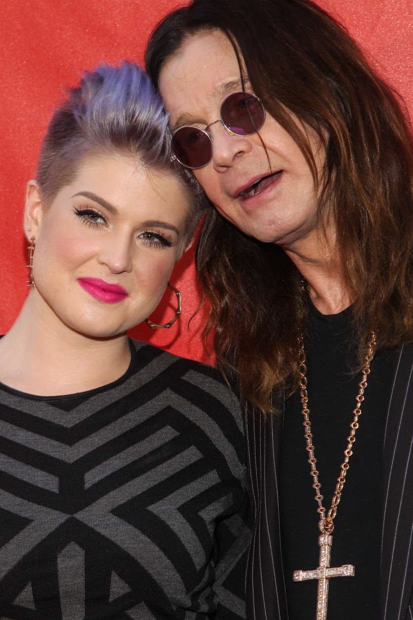 Kelly Osborne, left, and Ozzy Osbourne attend the 10th annual MusiCares MAP Fund Benefit Concert at Club Nokia on Monday, May 12, 2014 in Los Angeles. (Photo by Paul A. Hebert/Invision/AP)