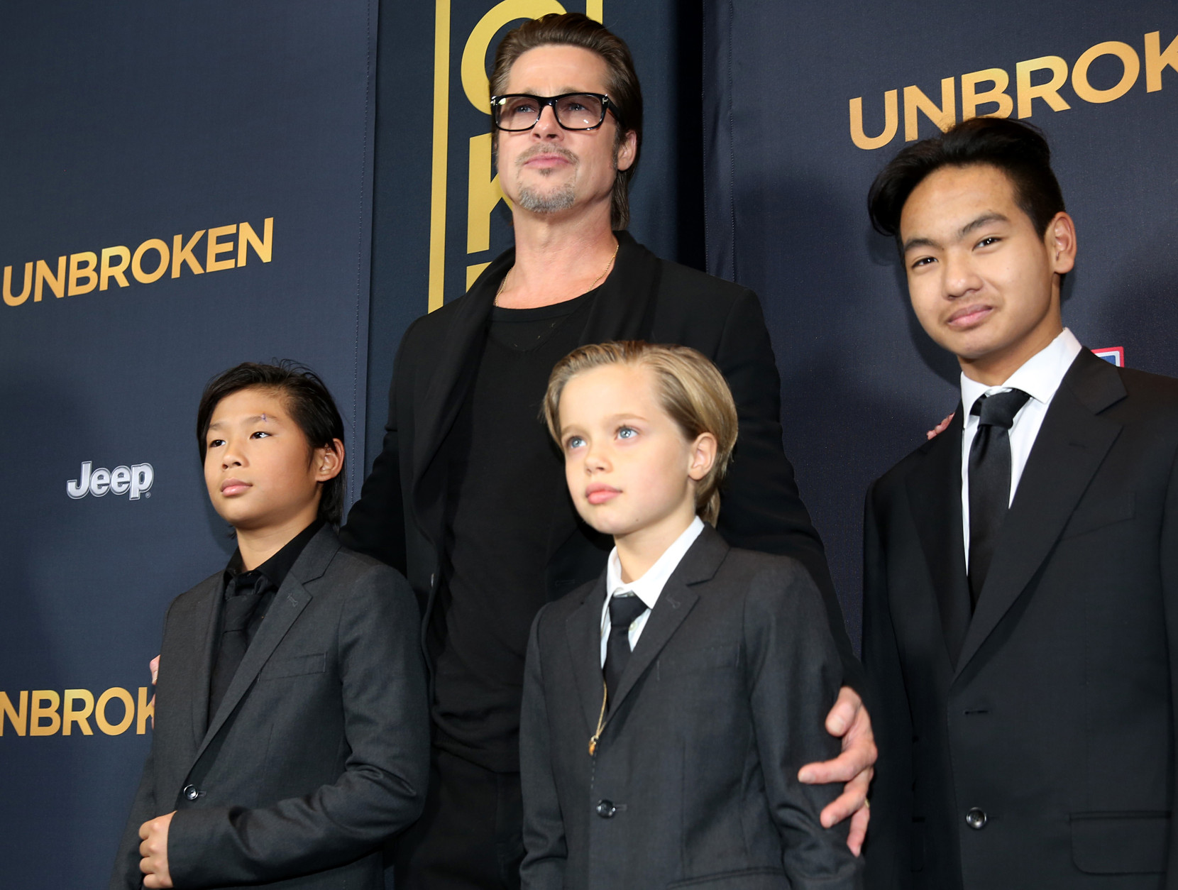 "Pax Jolie-Pitt, from left, Brad Pitt, Shiloh Jolie-Pitt and Maddox Jolie-Pitt arrive at the Los Angeles premiere of ""Unbroken"" at TCL Chinese Theatre on Monday, Dec. 15, 2014. (Photo by Matt Sayles/Invision/AP)"