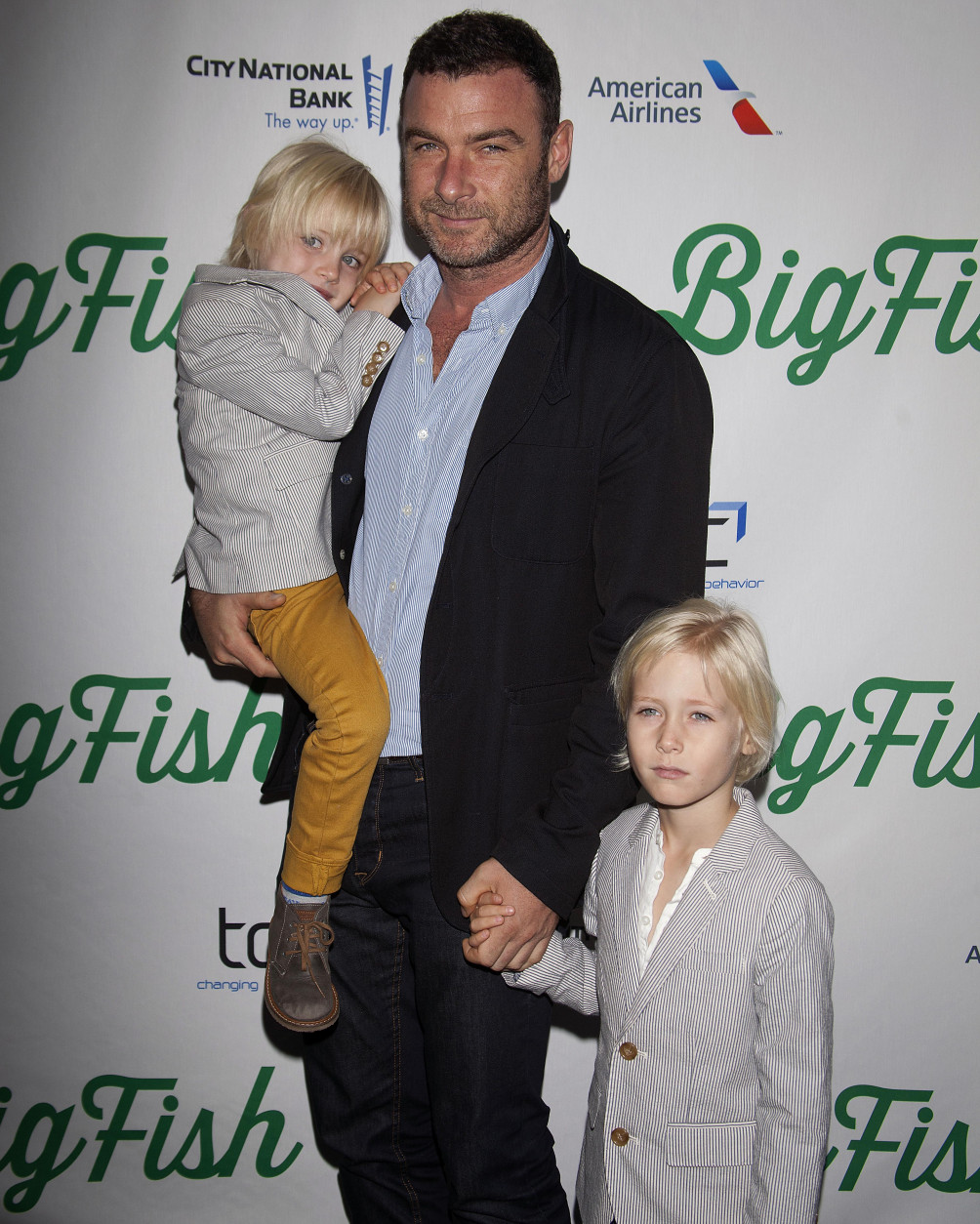 "FILE - In this Oct. 6, 2013 file photo, actor Liev Schreiber, center, with sons Samuel Kai Schreiber and Alexander Pete Schreiber arrive at the ""Big Fish"" Broadway Opening Night, in New York. Nothing is more important than family. That's what the stoic Hollywood fixer played by Schreiber tells his wife in the second season premiere of ""Ray Donovan."" While it's unclear whether his character believes his own words, Schreiber says that principle has shaped his career in recent years. (Photo by Carlo Allegri/Invision/AP, file)"