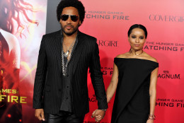 "Lenny Kravitz, left, and Zoe Kravitz arrive at the Los Angeles premiere of ""The Hunger Games: Catching Fire""  at Nokia Theatre LA Live on Monday, Nov. 18, 2013. (Photo by Jordan Strauss/Invision/AP)"
