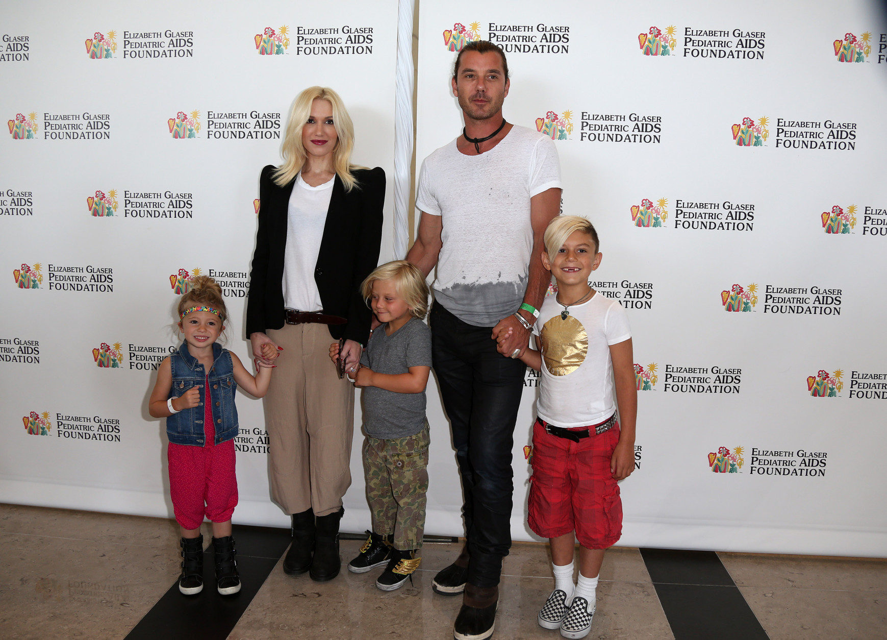 "Gwen Stefany and Gavin Rossdale arrive at Elizabeth Glaser Pediatric AIDS Foundation's 24th Annual ""A Time for Heroes"" event on Sunday, June 2, 2013 in Los Angeles. (Photo by Jose Flores/Invision/AP)"