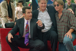 Actor Charlie Sheen, left, poses with his father, actor Martin Sheen, center, and brother, actor Emilio Estevez, after receiving his star on the Hollywood Walk of Fame in Los Angeles, Ca., on Sept. 23, 1994.  (AP Photo/Rhonda Birndorf)