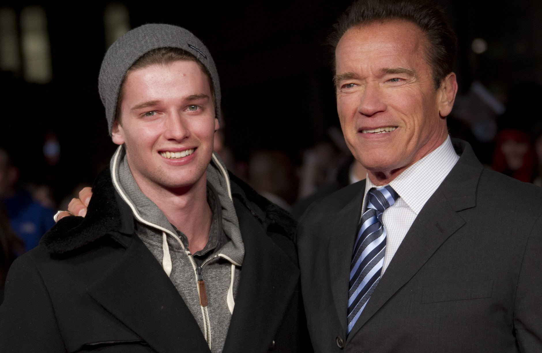Arnold Schwarzenegger and son Patrick, left, arrive for the European Premiere of The Last Stand at a central London cinema in Leicester Square, Tuesday, Jan. 22, 2013. (Photo by Joel Ryan/Invision/AP)