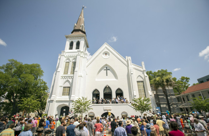 People Stand Outside As Parishioners Leave The Emanuel A M E Church Sunday June 21 2015 In Charleston S C Four Days After A Mshooting At The
