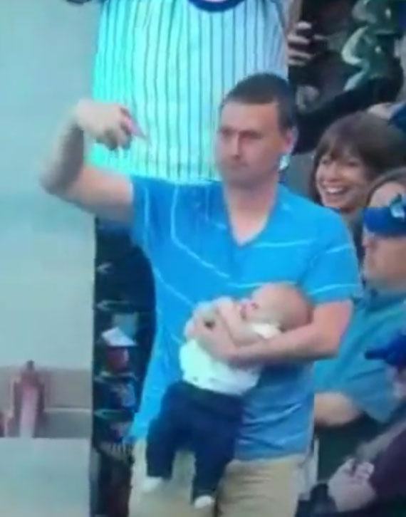 Dad catches foul ball while infant son doesn't spill a drop (Video)