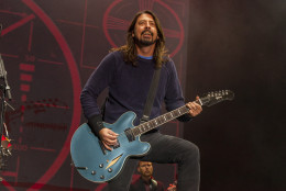 FILE - In this Nov. 2, 2014 file photo, Dave Grohl of the Foo Fighters performs at the Voodoo Music Experience in New Orleans. Grohl managed to finish a concert with a broken ankle, but he can't finish the Foo Fighters tour. The Foo Fighters announced Tuesday, June 16, 2015, that they're canceling the rest of their European tour after Grohl was injured in fall on stage in Sweden on Friday, June 12.  (Photo by Barry Brecheisen/Invision/AP, File)