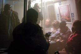 Smoke fills a Washington Metro system subway car near the L'Enfant Plaza station in Washington, Monday, Jan. 12, 2015.  (AP Photo/Andrew Litwin)