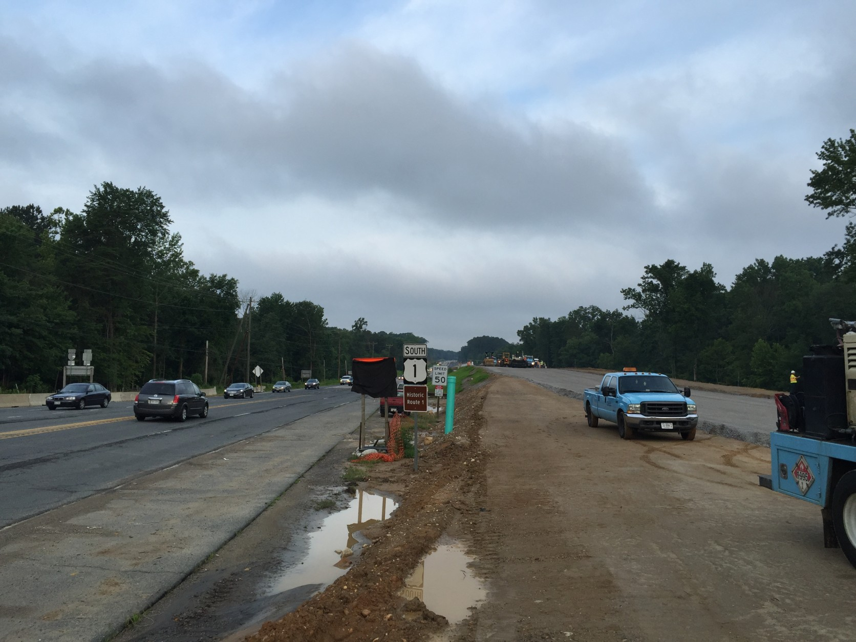 Crews working through the weekend are getting the last stretch of pavement to the Accotink Creek Bridge laid down just south of the Fairfax County Parkway. (WTOP/Kristi King)