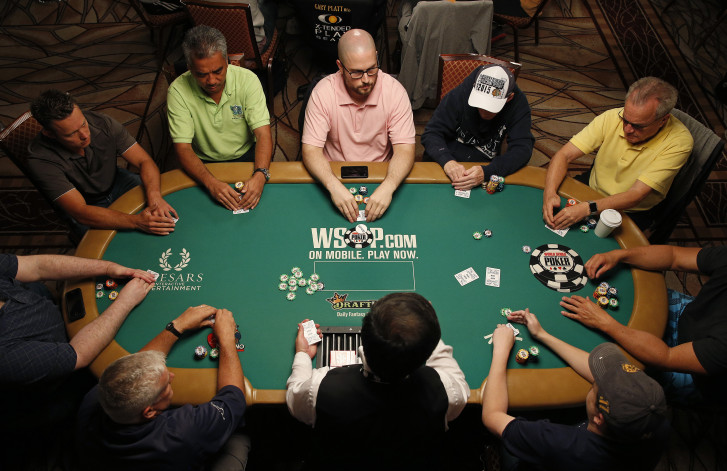 Players compete during the main event at the World Series of Poker Wednesday, July 8, 2015, in Las Vegas. Poker pros and a few celebrities are among 4,371
