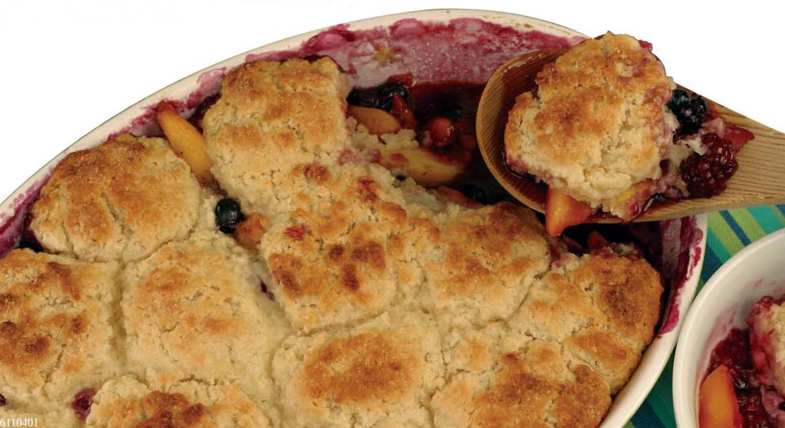 ** FOR USE WITH AP WEEKLY FEATURES **  Peach and Berry Almond Cobbler combines delectable summer fruits in a familiar dessert with a nontraditional bonus almond flavor in its dough, which includes almond paste. It's simple to make from scratch. (AP Photo/Andre Prost/Odense)