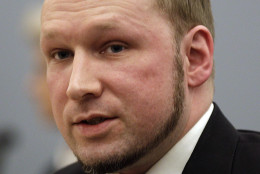 On this date in 2011, Anders Breivik massacred 69 people at a Norwegian island youth retreat after detonating a bomb in nearby Oslo that killed eight others. Here, Breivik  is seen in a courtroom after his trial on Aug. 24, 2012. (AP Photo/Frank Augstein)