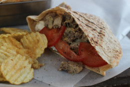 This Jan. 19, 2015 photo shows slow cooker pulled chicken Greek pitas in Concord, N.H. (AP Photo/Matthew Mead)