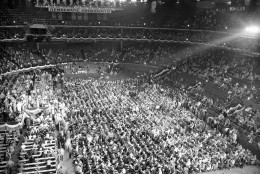 The first session of the Democratic National Convention was held in Chicago stadium on July 19, 1944. Speakers platform and press sections are at left, delegates sit in center floor section, and visitors and guests occupy top sections. Posters of Democratic presidents hang about top of convention hall (background). (AP Photo)