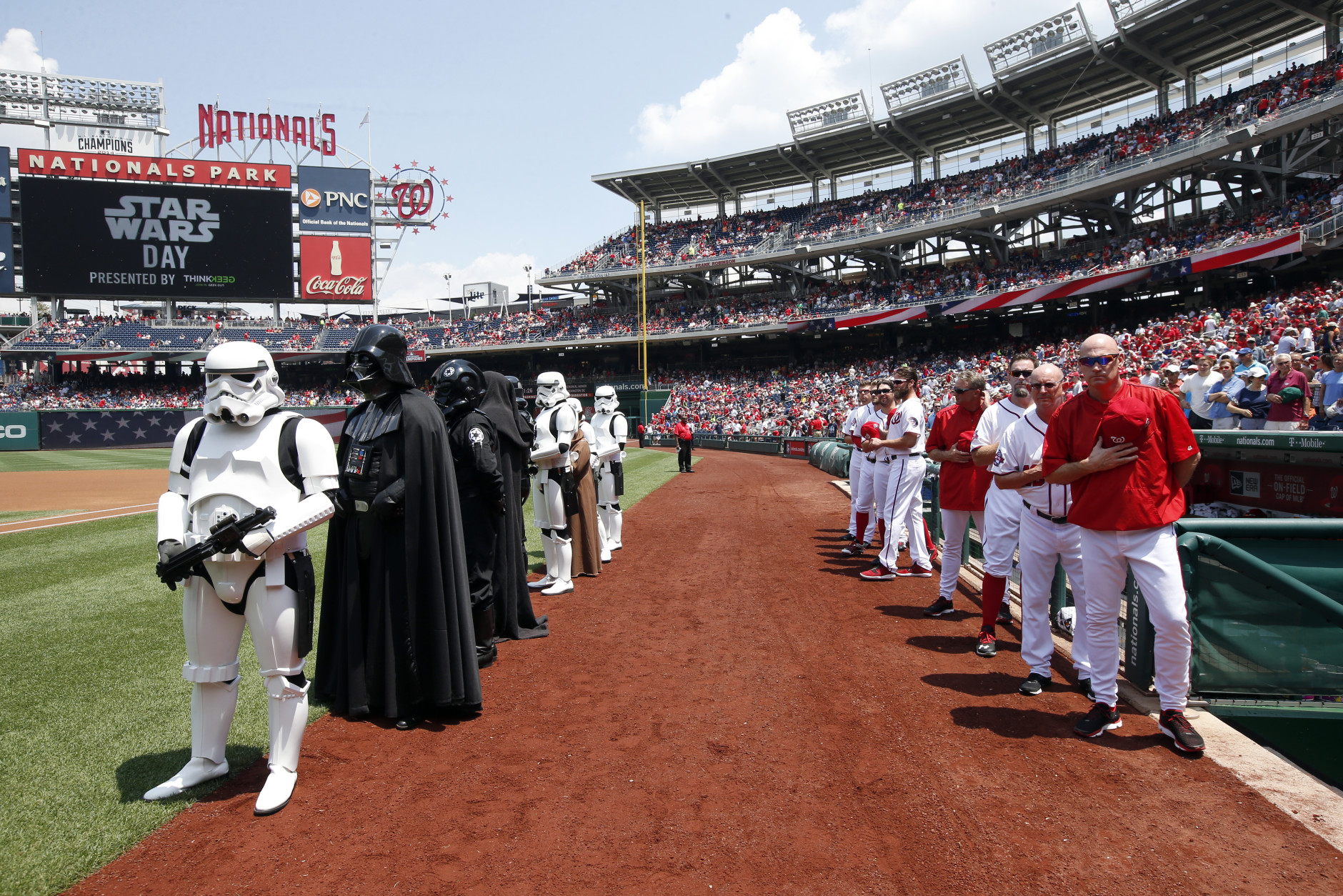 Star Wars characters in costume stand with the Washington Nationals after the national anthem on Star Wars day, before a baseball game against the Los Angeles Dodgers at Nationals Park, Sunday, July 19, 2015, in Washington. (AP Photo/Alex Brandon)