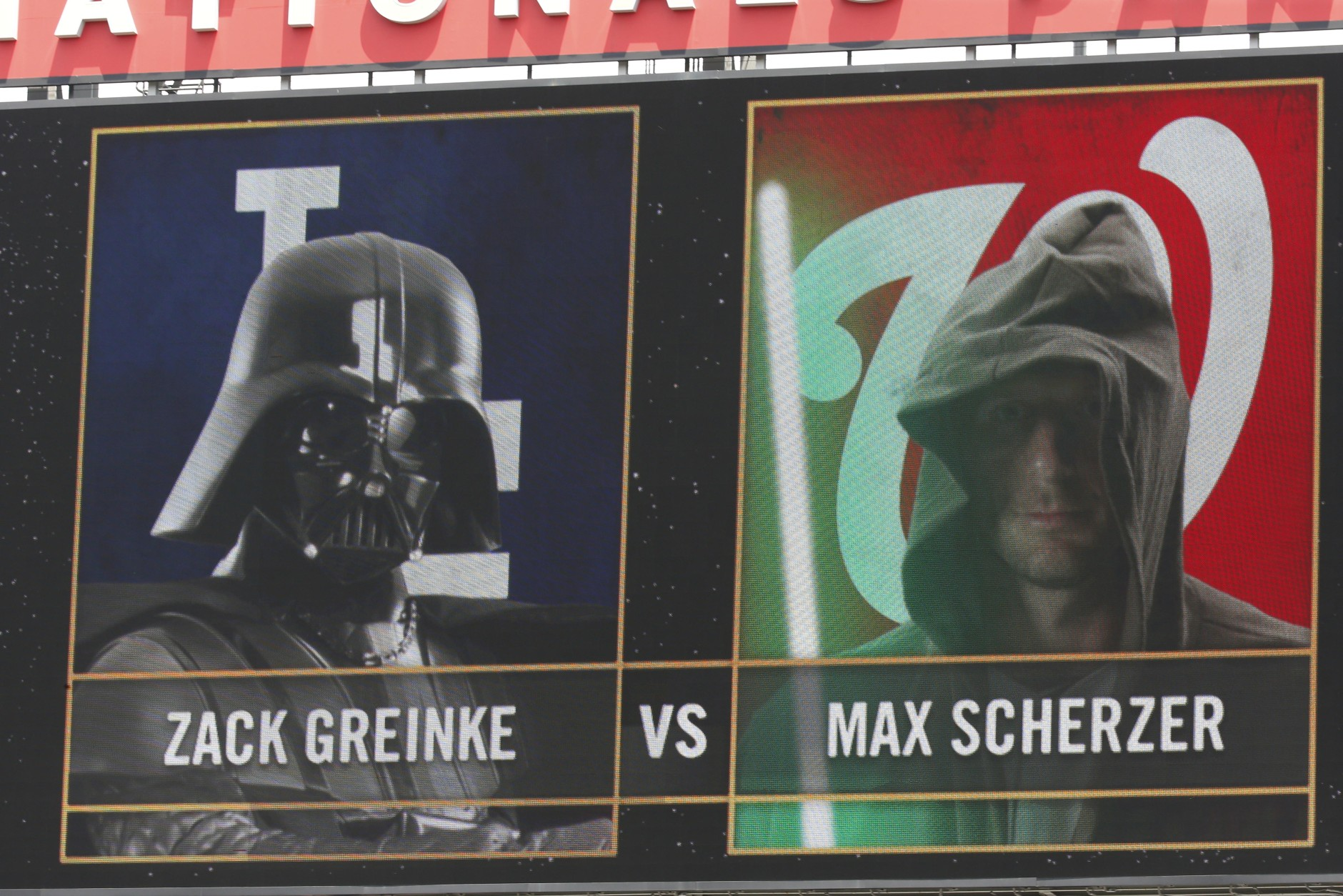 The scoreboard dispays the pitching matchup between Los Angeles Dodgers starting pitcher Zack Greinke and Washington Nationals starting pitcher Max Scherzer on Star Wars Day before a baseball game at Nationals Park, Sunday, July 19, 2015, in Washington. (AP Photo/Alex Brandon)