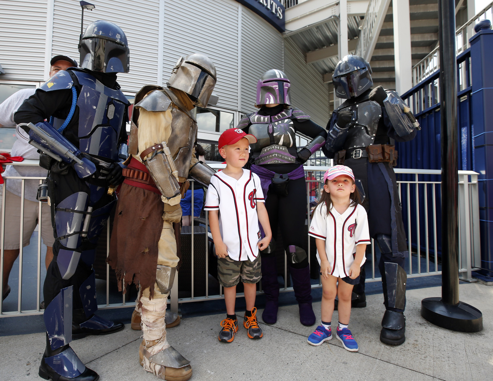 Carter Gamblin, left, 6, and Lauren Gamblin, 4, both from Arlington, Va., pose with Star Wars characters on Star Wars day before a baseball game between the Washington Nationals and the Los Angeles Dodgers at Nationals Park, Sunday, July 19, 2015, in Washington. (AP Photo/Alex Brandon)