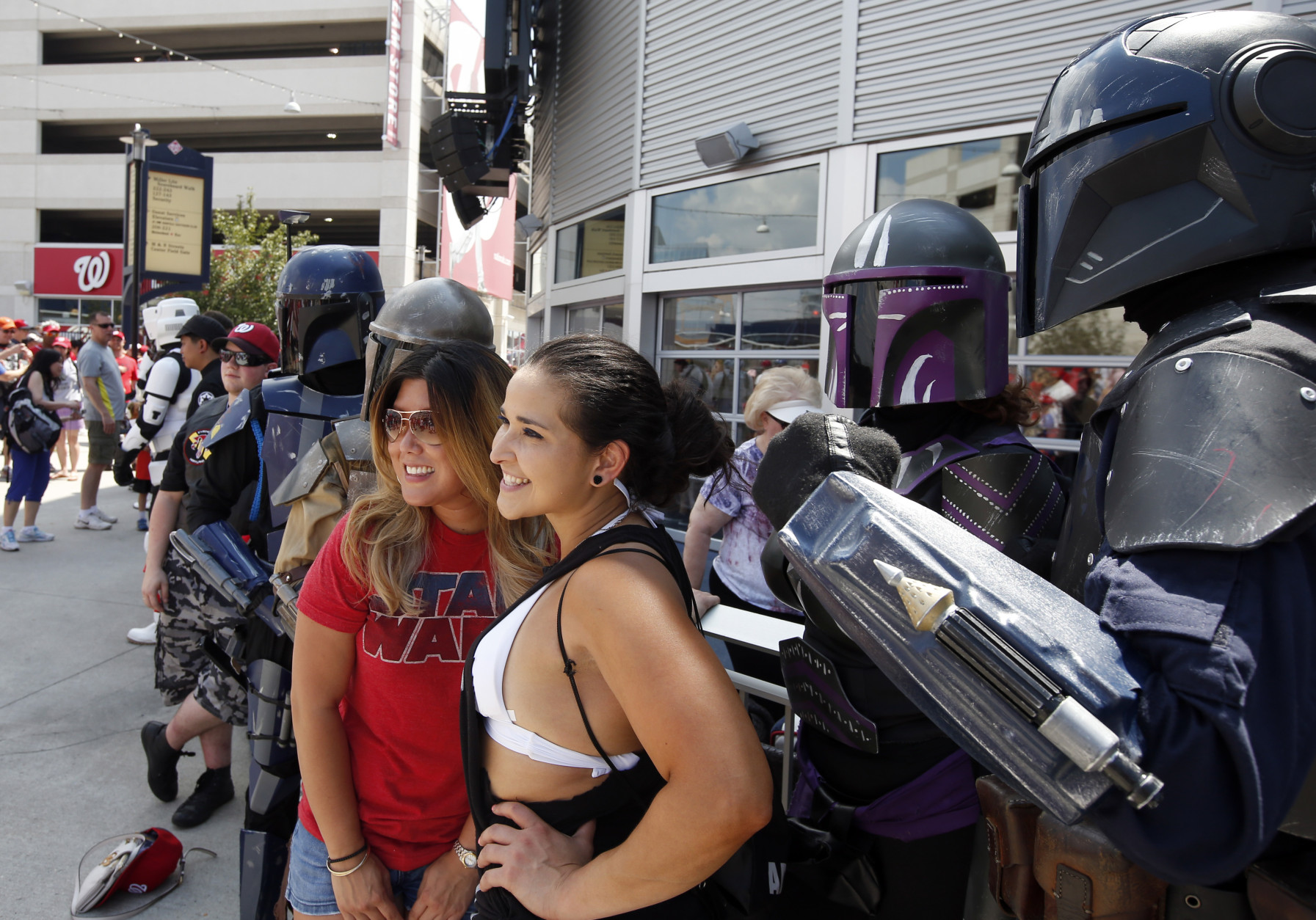 Fans pose with Star Wars characters on Star Wars day before a baseball game between the Washington Nationals and the Los Angeles Dodgers at Nationals Park, Sunday, July 19, 2015, in Washington. (AP Photo/Alex Brandon)