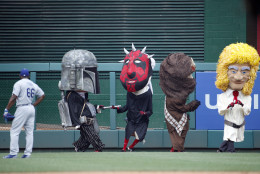 "Los Angeles Dodgers right fielder Yasiel Puig (66) watches the Washington Nationals mascots the ""Racing President,"" race as they are dressed up as Star Wars characters on Star Wars day during a baseball game at Nationals Park, Sunday, July 19, 2015, in Washington. (AP Photo/Alex Brandon)"