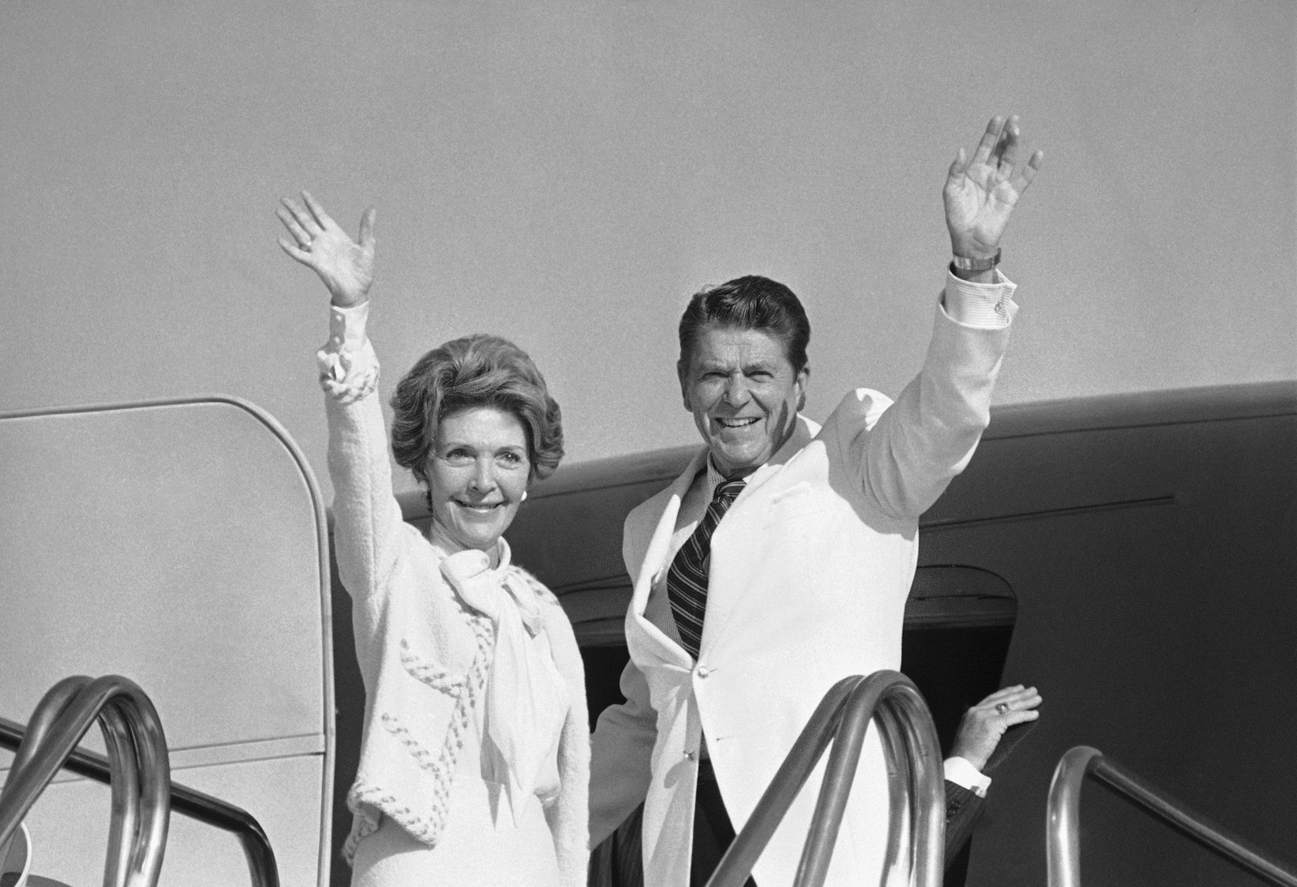 Former Gov. Ronald Reagan and his wife, Nancy, wave goodbye to crowd of newsmen Monday, July 14, 1980 in Los Angeles as he headed for the Republican National Convention in Detroit. In 1980, former California Gov. Ronald Reagan won the Republican presidential nomination at the party's convention in Detroit. He won the Republican presidential nomination at the party's convention in Detroit on July 16, 1980. (AP Photo/Wally Fong)