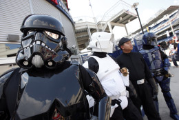 Star Wars characters are in full costume on Star Wars day before a baseball game between the Washington Nationals and the Los Angeles Dodgers at Nationals Park, Sunday, July 19, 2015, in Washington. (AP Photo/Alex Brandon)