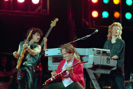 From left, John Oates, G.E. Smith and Daryl Hall perform collectively as Hall and Oates onstage at JFK Stadium in Philadelphia Pa. for the Live Aid famine relief concert July 13, 1985.(AP Photo/Amy Sancetta)