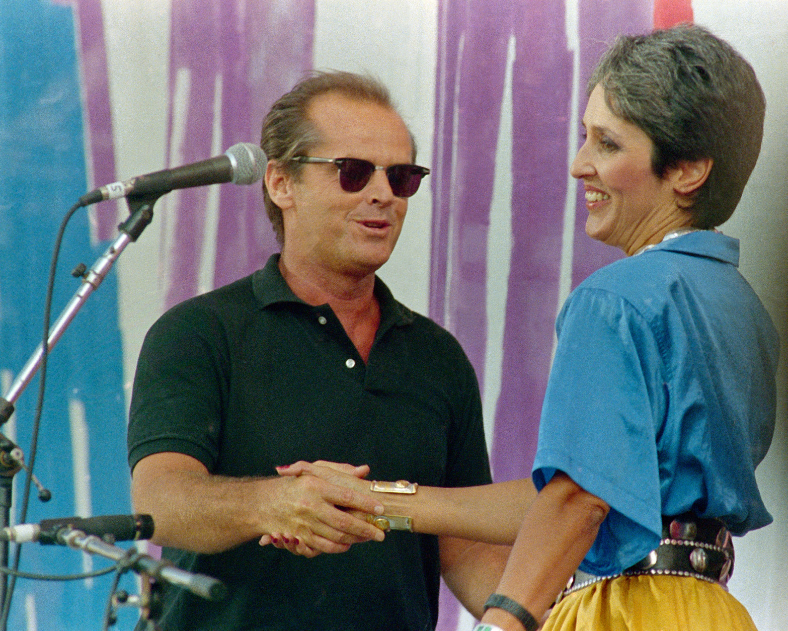 Actor Jack Nicholson, left, greets singer Joan Baez onstage, during the Live Aid concert for famine relief at JFK Stadium in Philadelphia, Pa. July 13, 1985.(AP Photo)