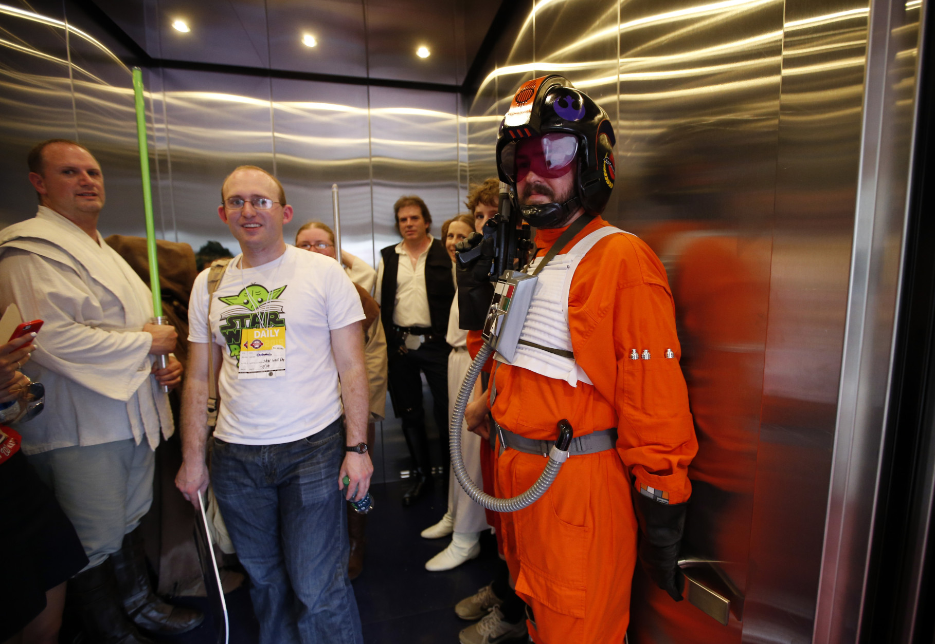 People dressed as Star Wars characters crowd in an elevator to take a break on Star Wars day before a baseball game between the Washington Nationals and the Los Angeles Dodgers at Nationals Park, Sunday, July 19, 2015, in Washington. (AP Photo/Alex Brandon)