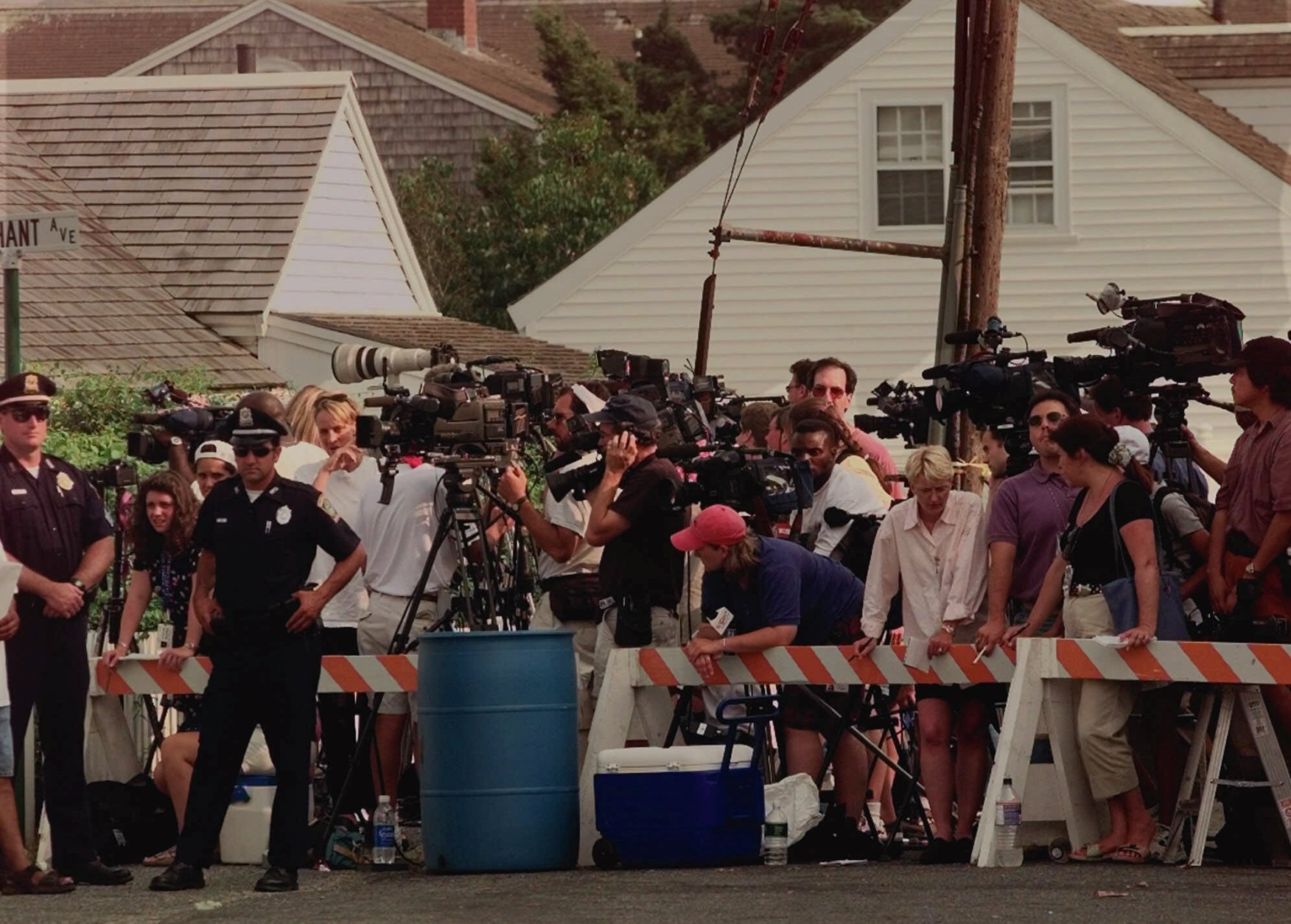 In 1999, John F. Kennedy Jr., his wife, Carolyn, and her sister, Lauren Bessette, died when their single-engine plane, piloted by Kennedy, plunged into the Atlantic Ocean near Martha's Vineyard, Massachusetts. Reporters surround the Kennedy Compound in Hyannisport, Mass., Saturday, July 17, 1999 after the wedding of Rory Kennedy, daughter of the late Robert Kennedy, was postponed after John F. Kennedy Jr., his wife and her sister were reported missing after their plane disappeared Friday night flying into Martha's Vineyard for the wedding. (AP Photo/Jim Cole)