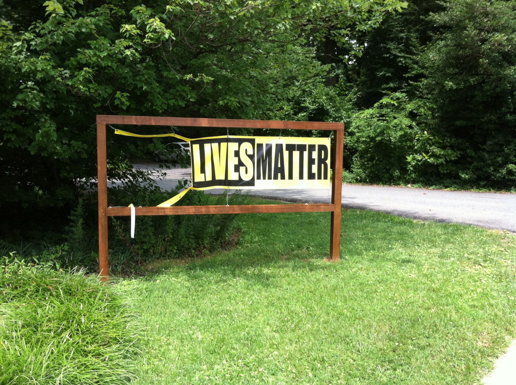 """The """"black lives matter"""" sign that was vandalized. (Courtesy Ana Maria K. Lim)"""