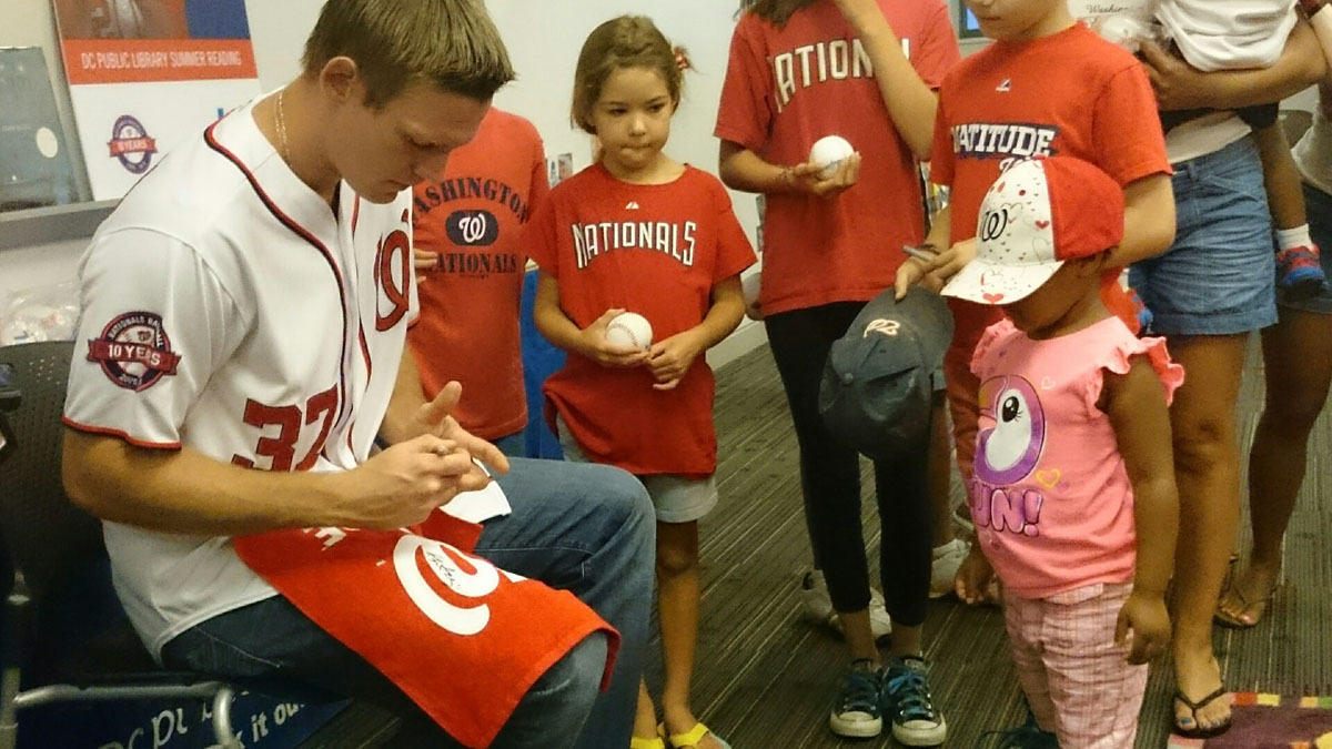 Nationals pitcher reads to fans at Anacostia Library