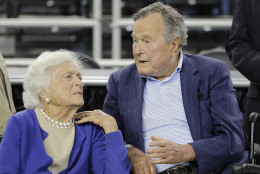 FILE - In this March 29, 2015, file photo, former President George H.W. Bush and his wife Barbara Bush, left, speak before a college basketball regional final game between Gonzaga and Duke, in the NCAA basketball tournament in Houston. Bush has fallen at home Wednesday, July 15, 2015, in Kennebunkport, Maine, and broken a bone in his neck. (AP Photo/David J. Phillip, File)