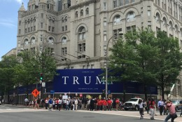 D.C. Council member Charles Allen says the construction sign outside Donald Trump's future hotel looks very similar to materials used in his presidential campaign.  (WTOP/Andrew Mollenbeck)