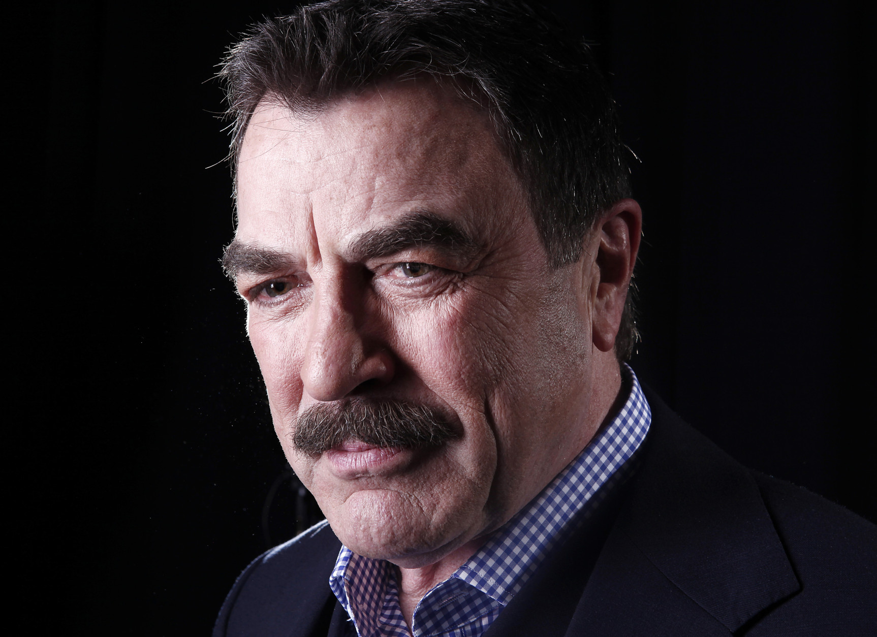 FILE - This March 21, 2012 file photo Actor Tom Selleck poses for a portrait in New York. A lawsuit accuses Selleck of stealing truckloads of water from a public hydrant and bringing it to his Southern California ranch. The suit filed Monday, July 6, 2015 by a Ventura County water district claims that on more than a dozen occasions a truck filled up at a hydrant and hauled the water to Selleck's 60-acre spread in Westlake Village.  (AP Photo/Carlo Allegri, File)