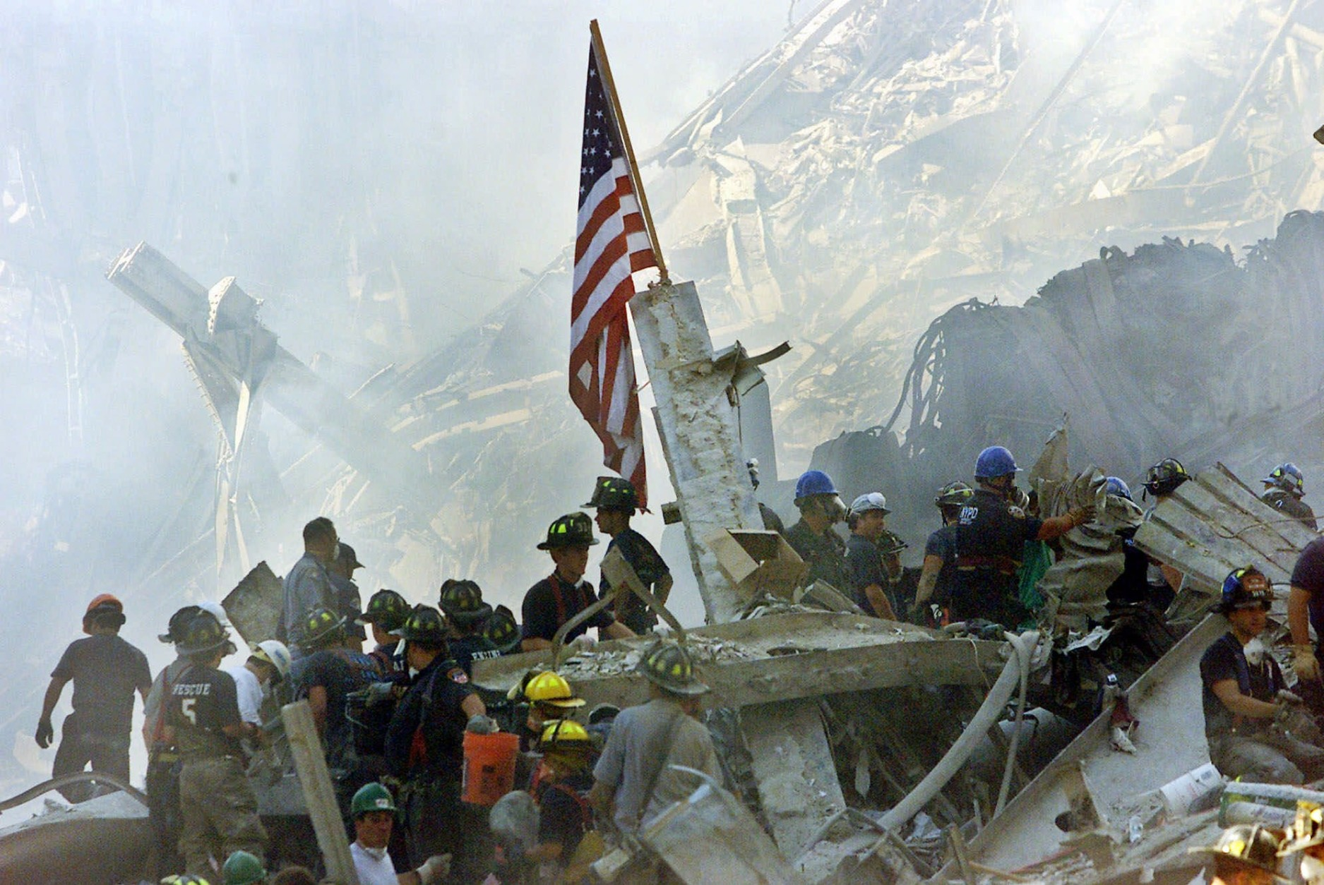 FILE - In this Sept. 13, 2001 file photo, a U.S. flag flies over the rubble of the collapsed World Trade Center buidlings in New York. Experts say there may be nowhere else in the world where flags stir more intense feelings than in the United States. (AP Photo/Beth A. Keiser)