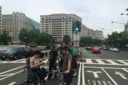 """""""It's fairly common for a cyclist to have a near miss or a collision with a vehicle that has struck them, making one of those illegal U-turns,"""" said Samantha Wetzel, who organized the gathering.(WTOP/Mike Murillo)"""