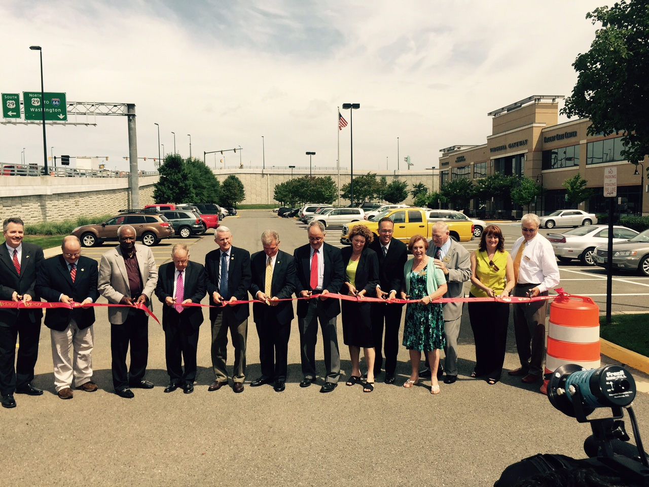 A ribbon cutting for the project in a parking lot next to interchange on Thursday. (WTOP/Max Smith)