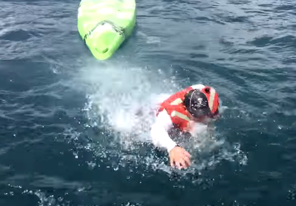 Fisherman pulled around by grouper gets bumped off kayak by shark (Video)