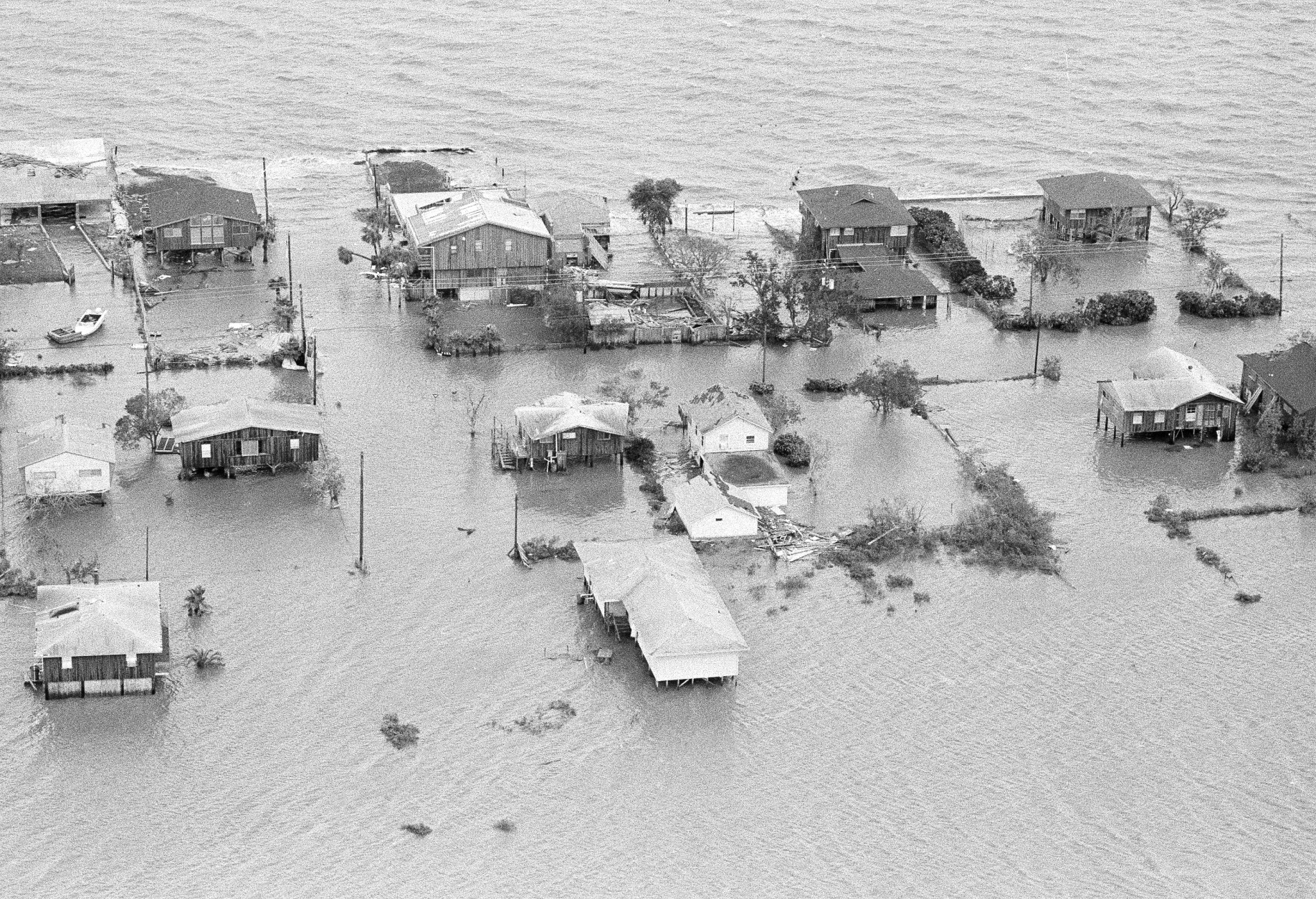 Galveston Bay over flows its banks into Seabrook, Texas early Thursday morning, August 19, 1983. The bay waters were forced ashore due to Hurricane Alicia which came ashore packing winds in excess of 115 miles per hour. (AP Photo)