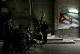 People play dominoes in the entrance of La Guarida, Havana's best known paladar, or private restaurant, in Havana, Monday, March 10, 2008. (AP Photo/Javier Galeano)