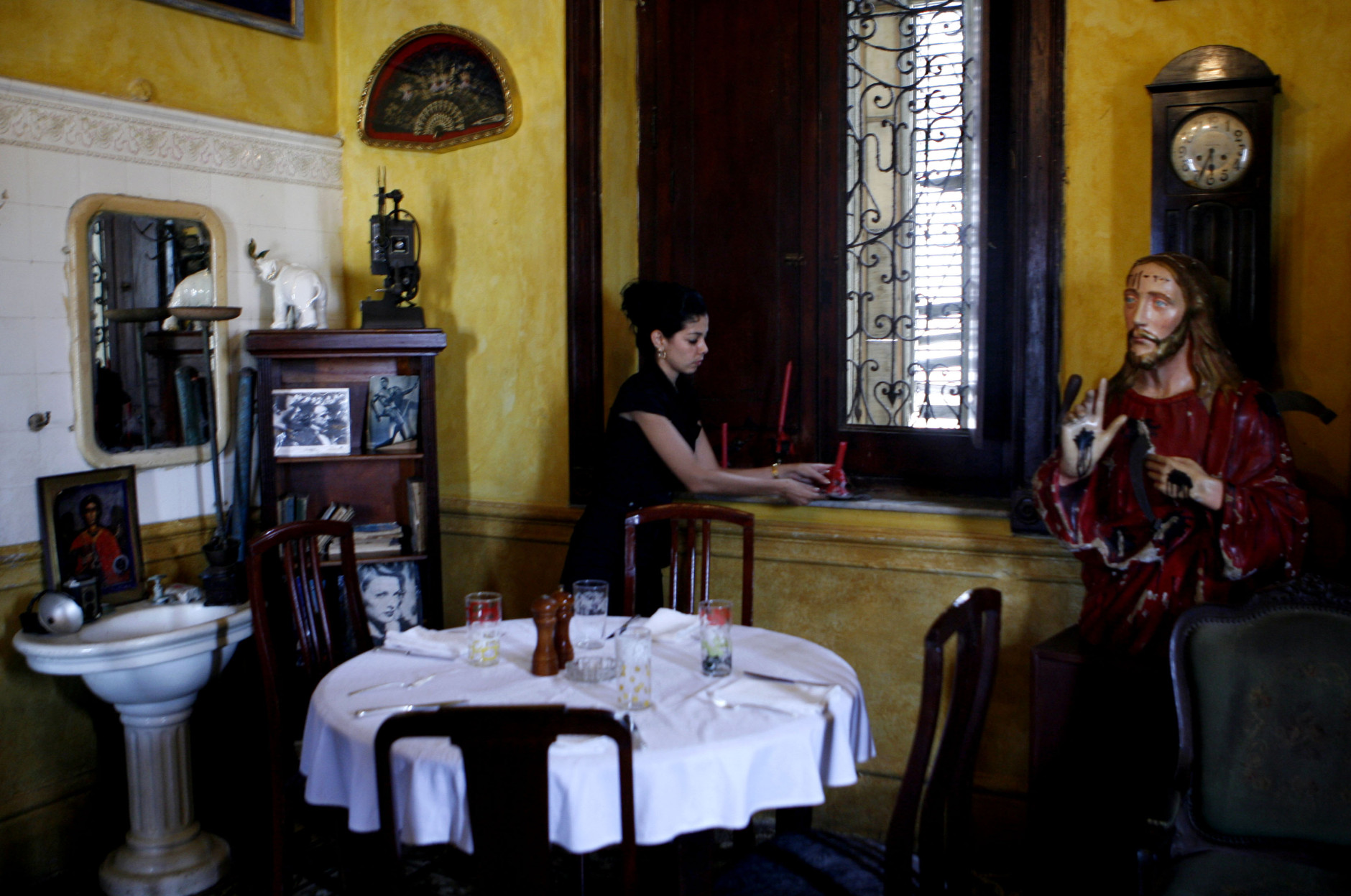 A worker gets ready to attend customers in La Guarida, Havana's best known paladar, or private restaurant, in Havana, Monday, March 10, 2008.  (AP Photo/Javier Galeano)