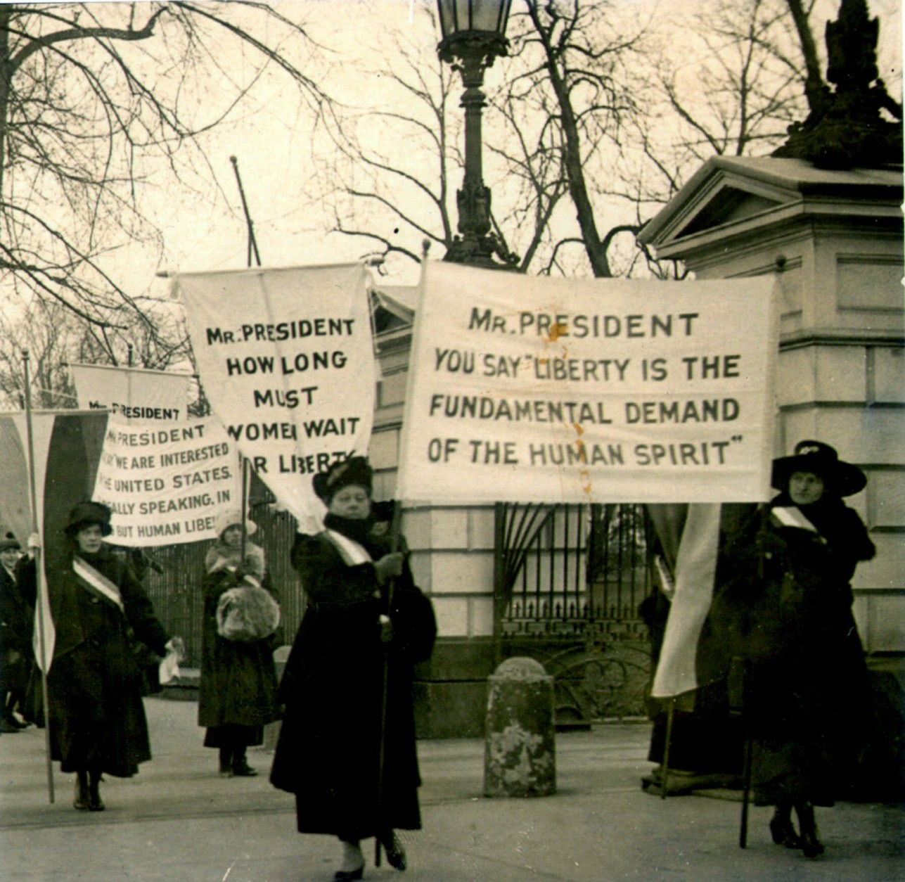 This is a circa 1918 photo of women demonstrating at the White House demanding voting rights. T(AP Photo)