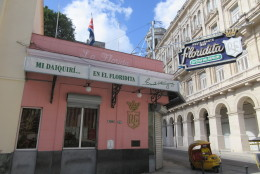 This May 16, 2015 photo shows the exterior of El Floridita, a bar and restaurant frequented by Ernest Hemingway that's a popular stop for tourists in Old Havana, Cuba. The local great air-conditioning, icy daiquiris and a bust of Hemingway, perfect for selfies. (AP Photo/Beth J. Harpaz)