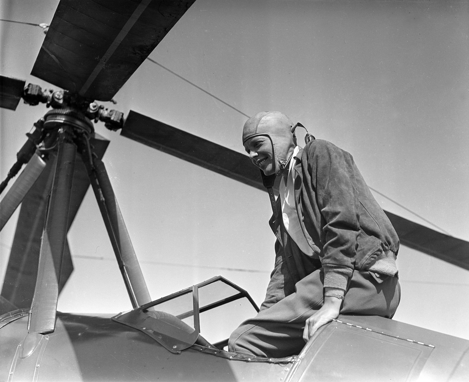 On this date in 1932, Amelia Earhart embarked on a 19-hour flight from Los Angeles to Newark, New Jersey, making her the first woman to fly solo, non-stop, from coast to coast. Here, Earhart is seen after a transcontinental flight in Oakland, Calif., on June 6, 1931.  (AP Photo)