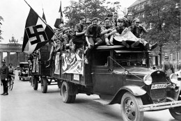 Young Nazis crowd on the back of a truck used for propoganda purposes advising people to vote 'Yes' in the great plebiscite as to whether Adolf Hitler should be elected President, in Berlin, Germany, Aug. 19, 1934. (AP Photo)